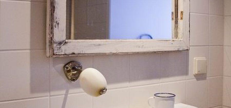 Cómo elegir un espejo para el cuarto de baño: sus pros y contras